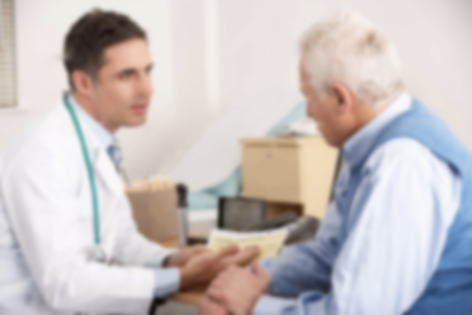 american-doctor-talking-to-man-surgery-23958705